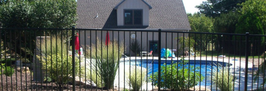 Photo: Home with ornamental aluminum fencing